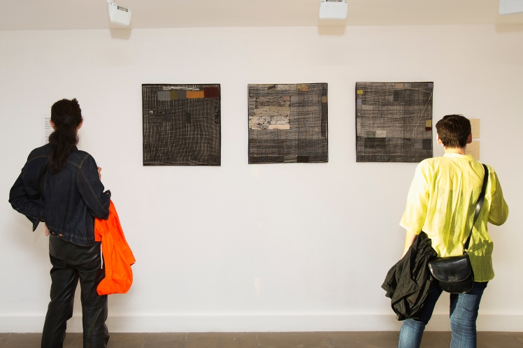 Visitors to Pumphouse Gallery look at work by Dorothy Caldwell. Photo courtesy Eoin Carey.